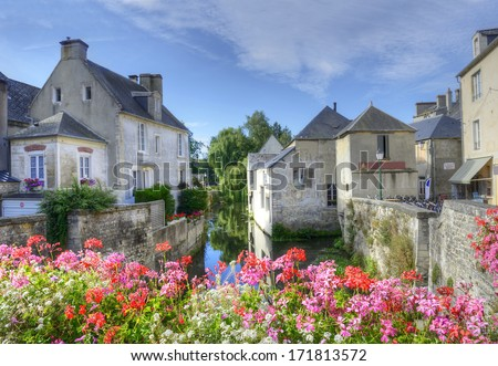 Evening on the river embankment of town Bayeux. Normandy, France - stock photo