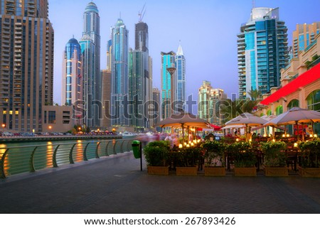 Evening on the waterfront Dubai Marina Basically, all the skyscrapers are located in two places of Dubai, along the Sheikh Zayed road and Dubai Marina. - stock photo