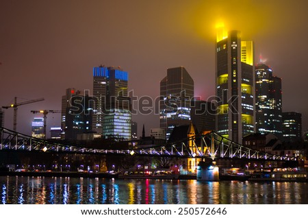 Evening panorama of Frankfurt Skyline (skyscrapers in downtown) in cloudy weather at night, view from Main river - architecture background, Frankfurt, Germany  - stock photo