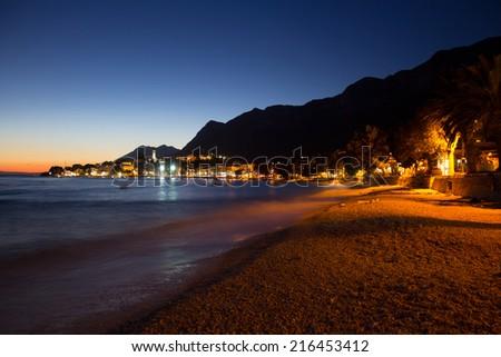 Evening panorama on the beach after dark in Gradac, Croatia - stock photo