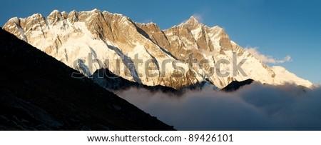 evening panoramatic view of Lhotse and Nuptse - stock photo