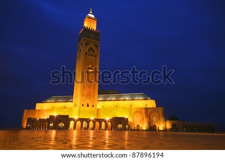 Evening panoramic view of illuminated Hassan II Mosque in Casablanca, Morocco - stock photo