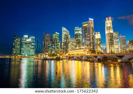 Evening photo of Singapore Downtown near city marina - stock photo