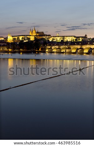Evening Prague gothic Castle and St. Nicholas' Cathedral with Charles Bridge, Czech Republic