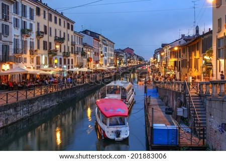 Evening scene along the Naviglio Grande canal in Milan, Italy. - stock photo