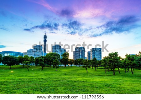 Evening scene of modern city with park in Yokohama, Japan. Yokohama is the third biggest city in Japan. - stock photo