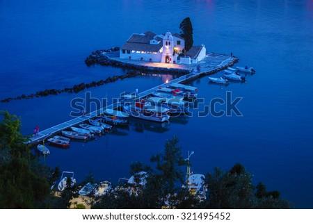 Evening scene of Vlacherna monastery and Pontikonisi island, Kanoni, Corfu, Greece - stock photo
