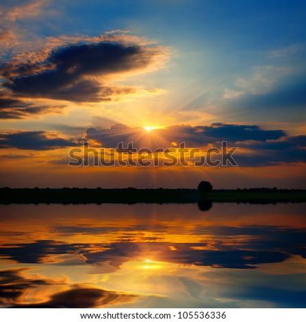 evening scene over lake water - stock photo