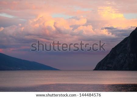 Evening scenery of The Lake Garda (Lago di Garda or Lago Benaco). Italian largest lake is located in Northern Italy. - stock photo