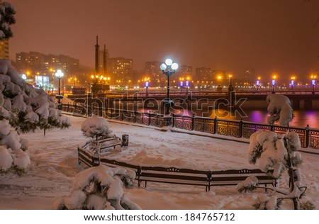 Evening shot of the promenade on the river Kalmius. Donetsk. Ukraine - stock photo