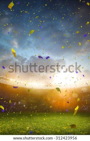 Evening stadium arena soccer field championship win! Confetti and tinsel . Yellow toning - stock photo
