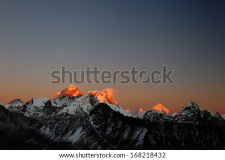 Evening sun on Mt Everest, Nuptse, Lhotse and Makalu, from Gokyo Ri, Nepal - stock photo