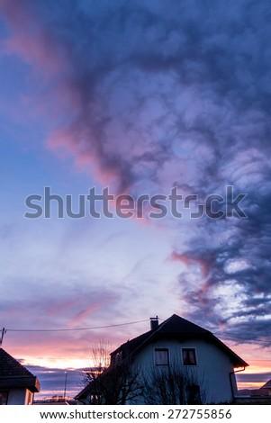 evening sun over a building, symbol of living, weather, idyllic - stock photo