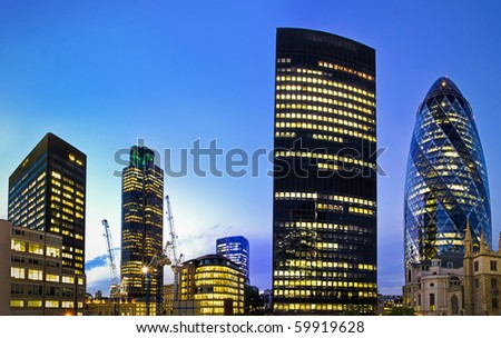 Evening time shot of London's famous skyscrapers including 'the Gherkin', Aviva and Tower 42 in the heart of it's financial district, The City.