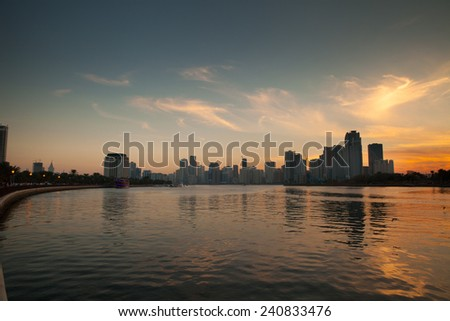 Evening time, sunset over the skyline of the city of Sharjah, United Arab Emirates. View from Blue Souk over the Lake Khalid.