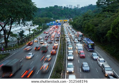 Evening traffic on the left driving road in Malaysia - stock photo