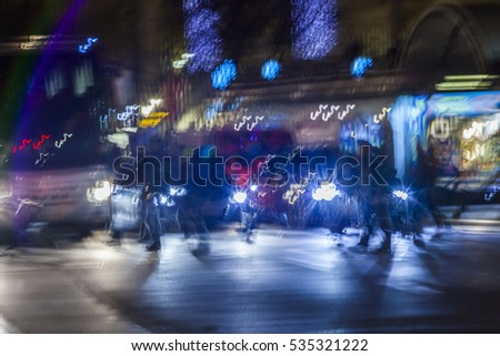 Evening traffic. The city lights. Motion blur.colorful street traffic bokeh .People walking over crossroad