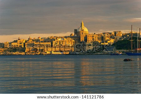 Evening Valletta, houses and St. Paul's Angclican Cathedral and Carmelite Church - stock photo