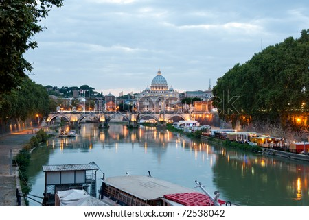 Evening view at the Angelo bridge and St. Peter's Basilica in Rome, Italy - stock photo