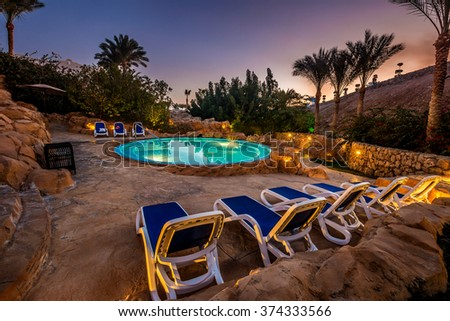 Evening view for luxury swimming pool in night illumination - stock photo
