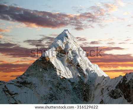 Evening view of Ama Dablam with beautiful clouds on the way to Everest Base Camp - Nepal - stock photo