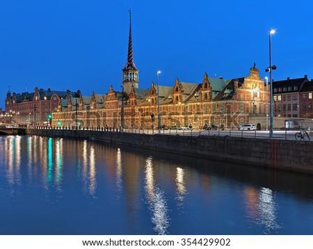Evening view of Borsen, a historic building of the Copenhagen Stock Exchange, Denmark. The building was build in 1619-1640 by design of the Flemish-Danish architect Hans van Steenwinckel the Younger. - stock photo