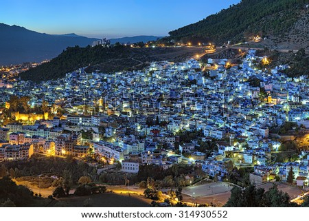 Evening view of Chefchaouen medina quarter with buildings painted in blue color from the hill of Jemaa Bouzafar Mosque, Morocco - stock photo