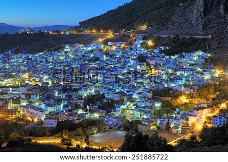 Evening view of Chefchaouen medina with buildings painted in blue color, Morocco - stock photo