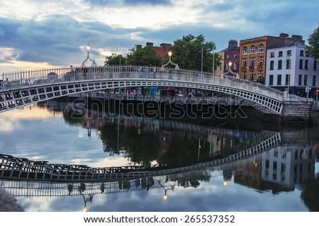 Evening view of famous Ha Penny Bridge in Dublin, Ireland - stock photo