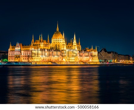 Evening view of Parliament building. Night scene in Budapest is World Heritage Site by UNESCO, Hungary, Europe. Artistic style post processed photo.