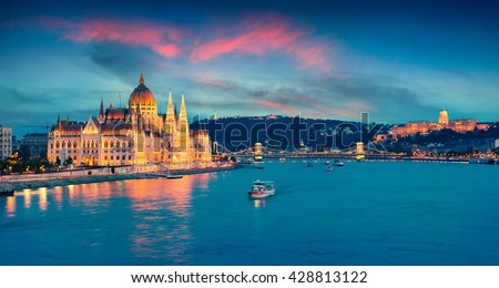 Evening view of Parliament, Chain Bridge and Buda Castle. Colorful sanset in Budapest, Hungary, Europe. Artistic style post processed photo. - stock photo
