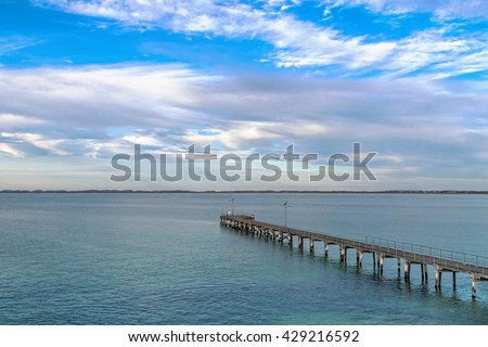 Evening view of Robe Jetty with blue sky and clouds in Robe, South Australia - stock photo