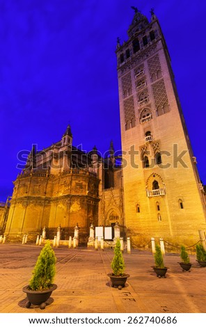Evening view of  Seville Cathedral with Giralda tower. Spain  - stock photo