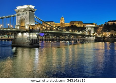 Evening view of Szechenyi Chain Bridge over Danube and Royal Palace in Budapest, Hungary - stock photo