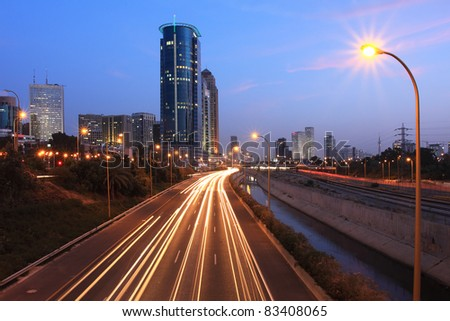 Evening view on Ayalon highway and modern buildings at down town of Tel Aviv, Israel.