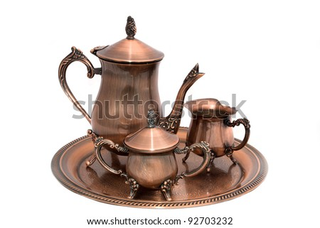 Evening with coffee. Copper coffee set. - stock photo