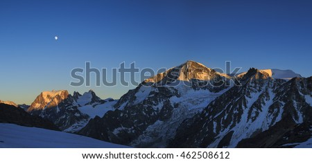 Evening with full moon in the Swiss Alps with a majestic view on Mont Collon.
