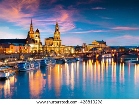 Evennig view of  Cathedral of the Holy Trinity or Hofkirche, Bruehl's Terrace or The Balcony of Europe. Colorful sunset on Elbe river in Dresden, Saxony, Germany, Europe.
