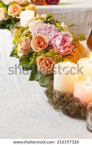 Event party or wedding decoration with candles and flowers on the table - stock photo