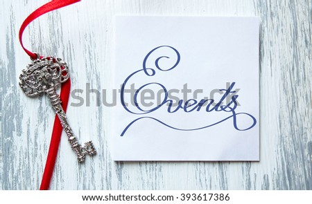 Events  Inspirational quote women's hand lettering for posters writing notebook note turquoise wooden background Word refer news, current affairs, special occasions business planning - stock photo