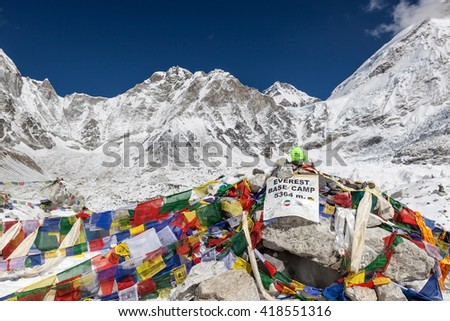 EVEREST BASE CAMP TREK/NEPAL - NOVEMBER 01, 2015: Everest Base Camp sign with stones and buddhist prayer flags and mountain Everest on the background. Everest Base Camp landmark.