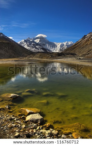 Everest reflection in the waters of picturesque lake. - stock photo
