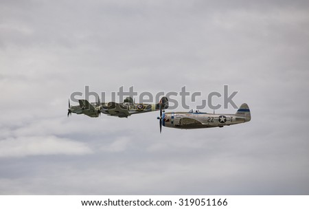 EVERETT - SEPTEMBER 20: A restored World War 2 Supermarine Spitfire, P-47 Thunderbolt and a Messerschmitt BF 109  was seeing flying in the skies over Everett Paine Field on 20 Sep 2015.