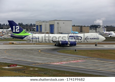 EVERETT, WA - JAN 31: Boeing unveils Seattle Seahawks 747 plane in celebration of the Seahawks going to the Super Bowl, on Jan 31, 2014 in Everett, Washington - stock photo