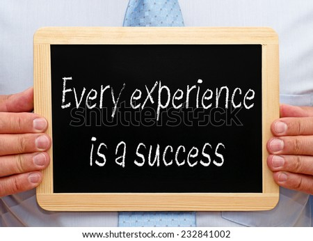 Every experience is a success - Businessman with chalkboard - stock photo