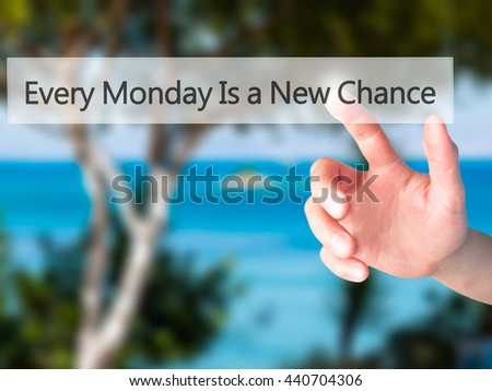 Every Monday Is a New Chance - Hand pressing a button on blurred background concept . Business, technology, internet concept. Stock Photo - stock photo