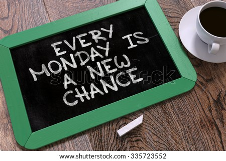 Every Monday is a New Chance. Inspirational Quote Hand Drawn on Green Chalkboard on Wooden Table. Business Background. Top View. - stock photo