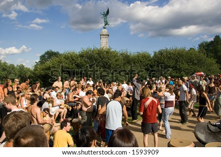 Every Sunday in Summer, Montrealers gather in Mont Royal park to dance and play drums. - stock photo
