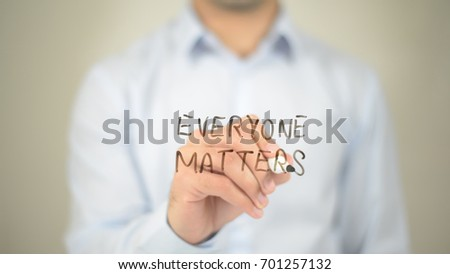 Everyone Matters, man writing on transparent screen
