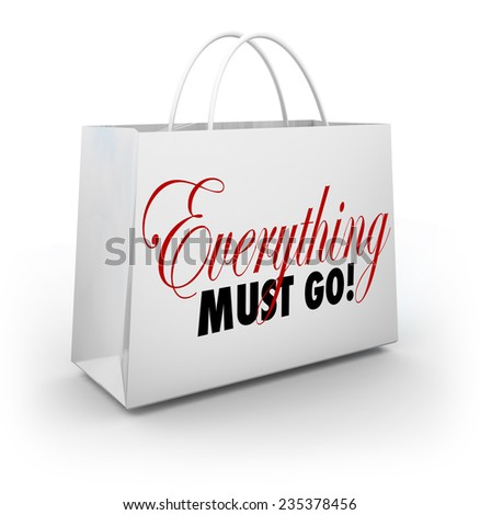 Everything Must Go words on a white shopping bag at a store holding a Going Out of Business sale to clear out its inventory - stock photo